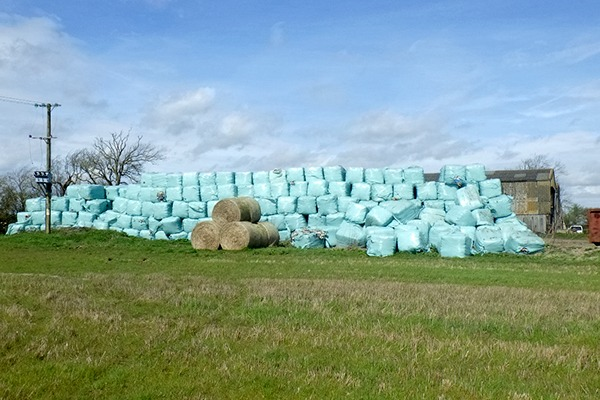 Bales of waste in a field. Photograph: Environment Agency