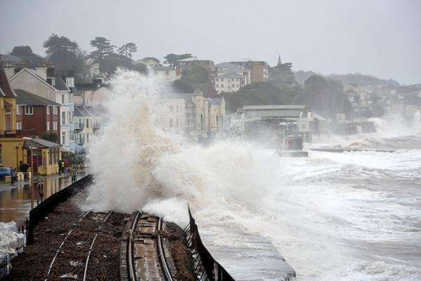 Dawlish railway suffers flooding and storm damage