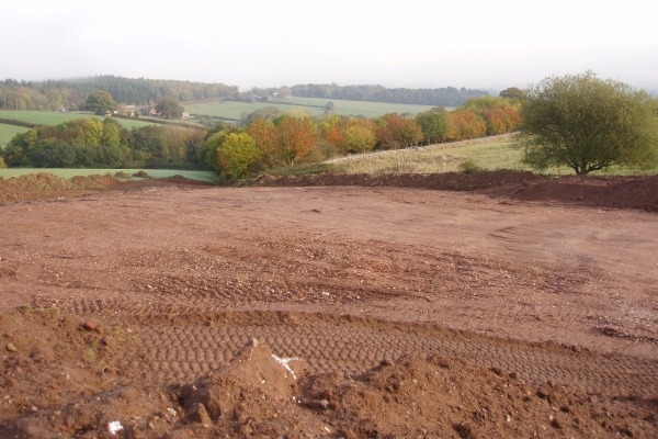 Construction waste dumped on farmland for 'drainage works'