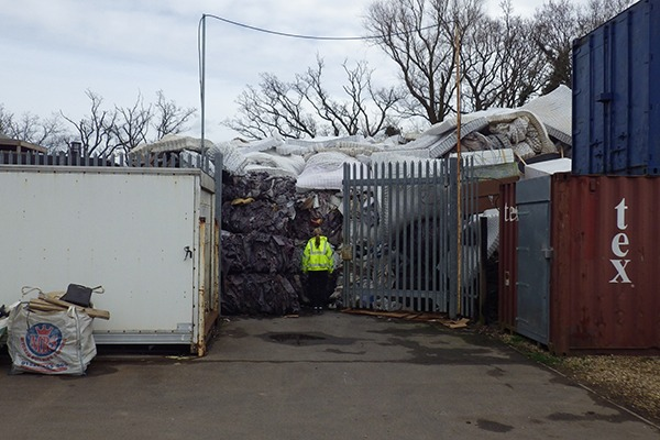 Environment Agency officer inspecting illegal waste mattress dump
