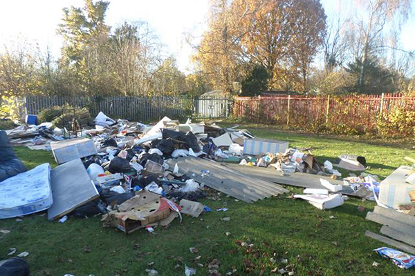 Fly-tipped waste at Hatchend playing field