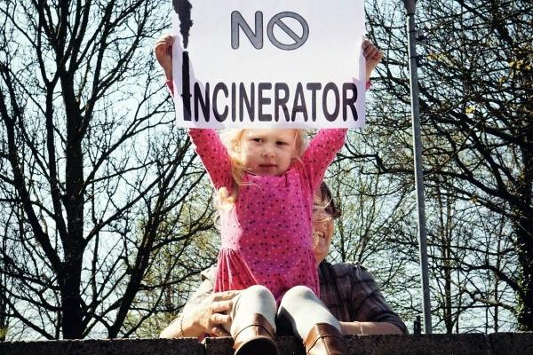 Little girl holds 'NO INCINERATOR' sign