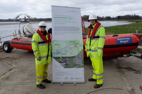 Alison Curtis and Mireia Artigas from Aecom standing in front of a boat