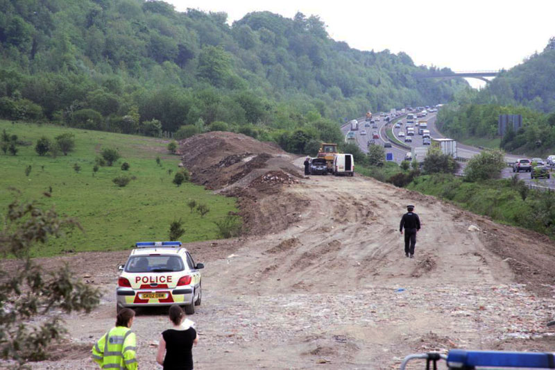 Environment Agency officers and police raid the illegal waste dump near the M25 in Kent