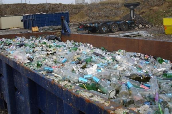Skip full of waste glass