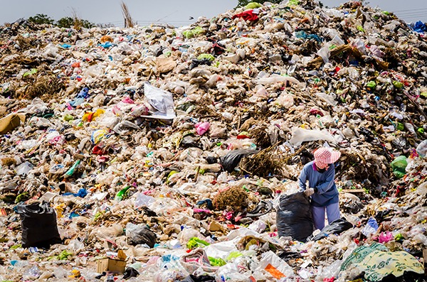 People working in landfill in Thailand