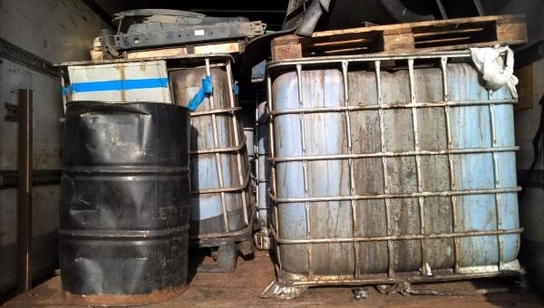 Containers of waste oil dumped in a truck