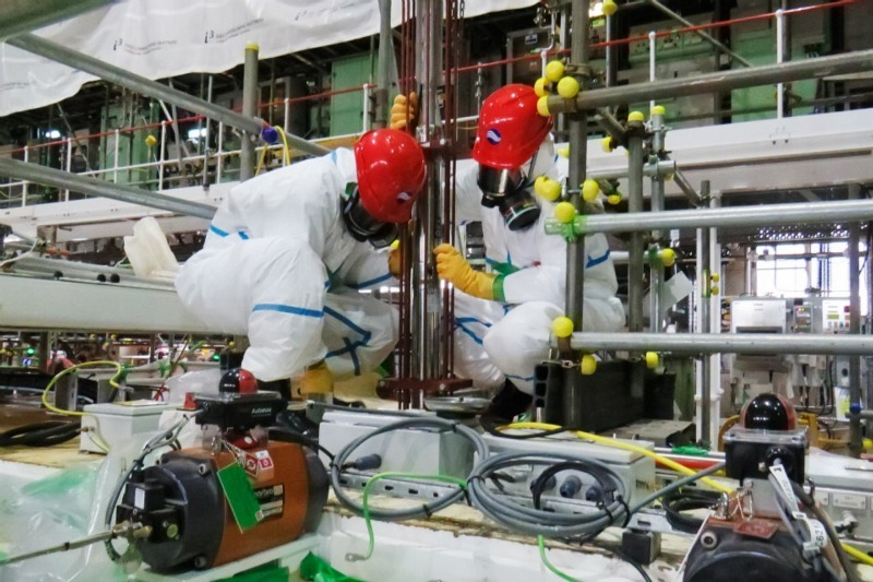 Workers extracting radioactive liquor at Sellafield nuclear plant