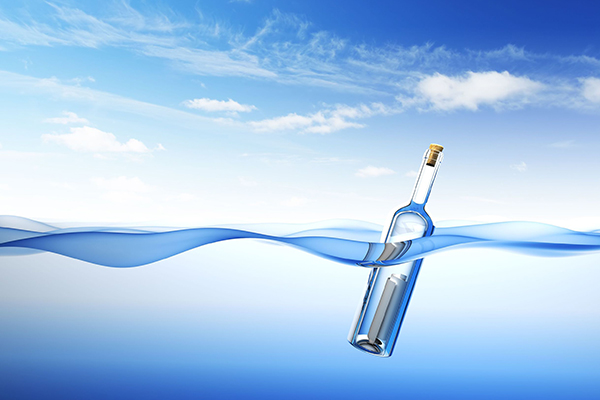 Illustration of a message in a bottle in bobbing in the water