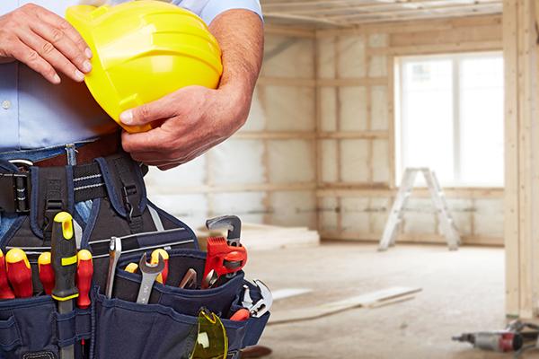 Man holding hard had and tools