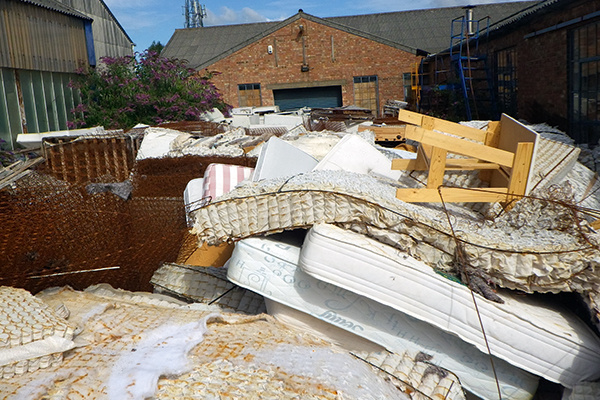 Piles of abandoned mattresses