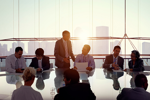 People sitting around a meeting table
