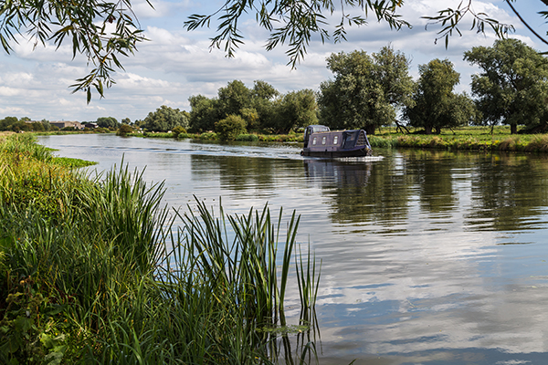 Canal boat on the river Ely