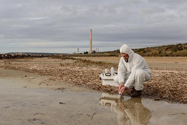Man taking water sample